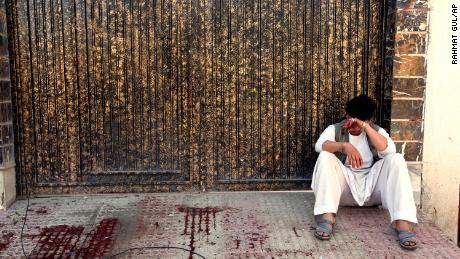 A relative of a victim cries outside a voter registration center which was attacked by a suicide bomber in Kabul, Afghanistan, Sunday, April 22.