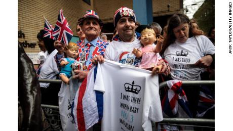 Royal fans wait behind barriers outside St Mary's Hospital ahead of the birth of the Duke and Duchess of Cambridge's third child.