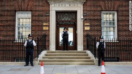 Police officers stand guard outside the Lindo Wing of St Mary's Hospital ahead of the birth.