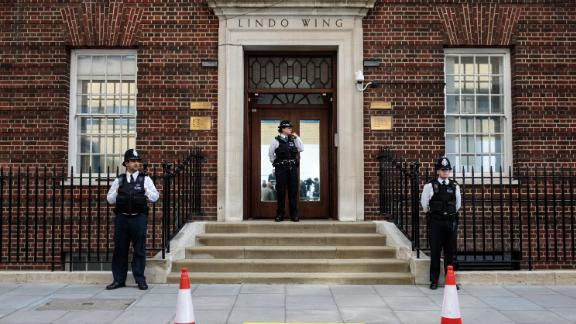 Police officers stand guard outside the Lindo Wing of St Mary