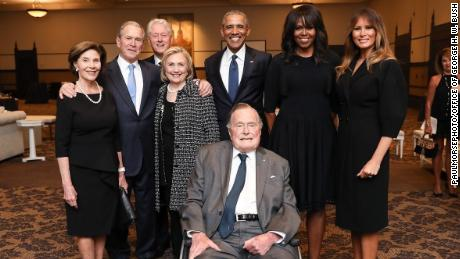 Former presidents Barack Obama, George W. Bush, Bill Clinton and George H. W. Bush -- along with first lady Melania Trump and former first ladies Michelle Obama, Laura Bush and Hillary Clinton, pose for a picture.