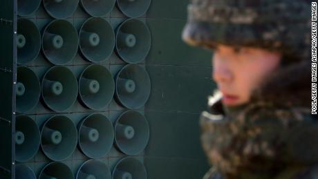 YEONCHEON, SOUTH KOREA - JANUARY 08: (SOUTH KOREA OUT) A South Korean soldier stands next to the loudspeakers near the border area between South Korea and North Korea on January 8, 2016 in Yeoncheon, South Korea. South Korea announced on January 7, 2016 that it would resume the broadcasts from the loudspeakers placed along the border, criticizing the North in response to its nuclear test. In August 2015, when the South Korean soldiers were maimed by land mines in DMZ, South Korea started the loudspeaker broadcasts and the North threatened to attack the speakers.  (Photo by Korea Pool-Donga Daily via Getty Images)