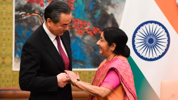 Indian Foreign Minister Sushma Swaraj shakes hands with Chinese Foreign Minister Wang Yi  April 22, 2018.