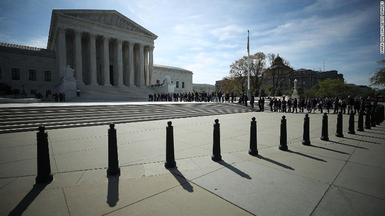 People wait in line to enter the U.S. Supreme Court, on April 23, 2018 in Washington, DC.