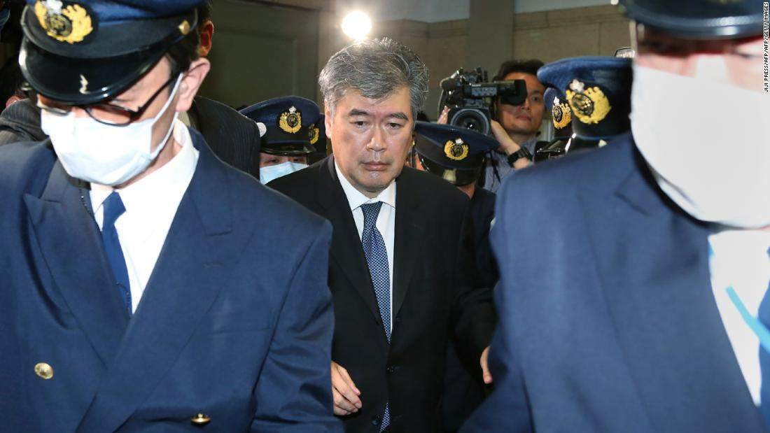 Japan's Administrative Vice Finance Minister Junichi Fukuda leaves the finance ministry in Tokyo amid allegations of sexual harassment.