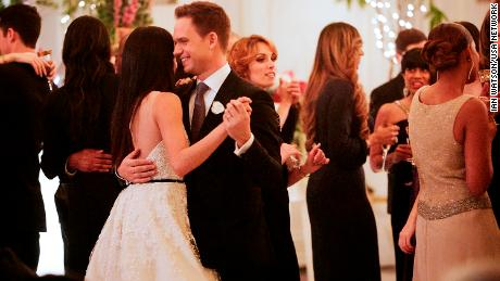 "Mike and Rachel talk down the aisle in ""Good-Bye,"" the season 7 finale of ""Suits."""