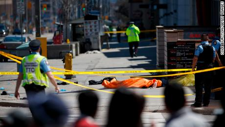 TORONTO, ON - APRIL 23: A tarp lays on top of a body on Yonge St. at Finch Ave. after a van plowed into pedestrians on April 23, 2018 in Toronto, Canada. A suspect is in custody after a white van collided with multiple pedestrians. (Photo by Cole Burston/Getty Images)