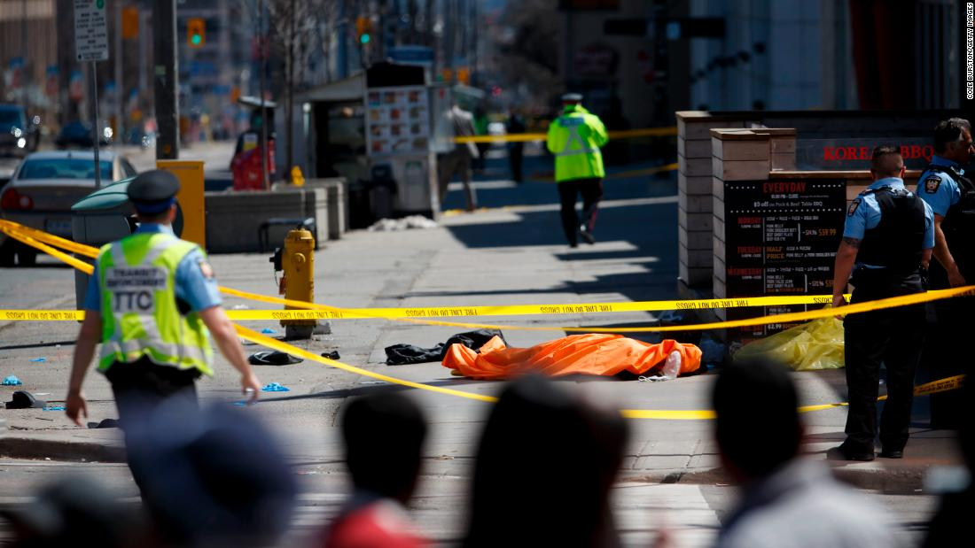 A tarp covers a victim's body on Yonge Street at Finch Avenue in Toronto.