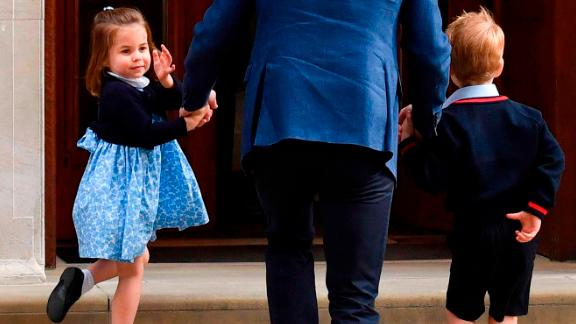 Charlotte turns to wave at journalists as she arrives with her father and her brother George to meet the newest member of their family, her brother Prince Louis, in April 2018.