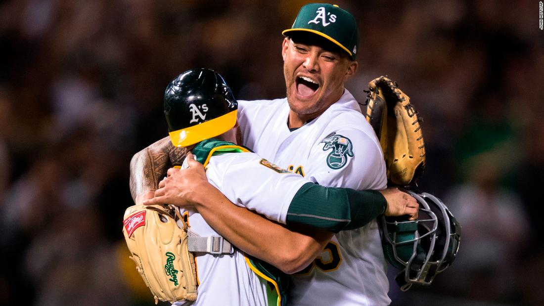 "Oakland pitcher Sean Manaea, right, celebrates with catcher Jonathan Lucroy after <a href=""https://bleacherreport.com/articles/2771847-sean-manaea-strikes-out-10-en-route-to-no-hitter-vs-scorching-hot-red-sox"" target=""_blank"">throwing a no-hitter against Boston</a> on Saturday, April 21. It was the first no-hitter of the season."