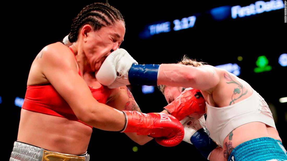 Heather Hardy, right, punches Paola Torres during their featherweight bout in New York on Saturday, April 21. Hardy won by unanimous decision and remains undefeated in her professional boxing career.