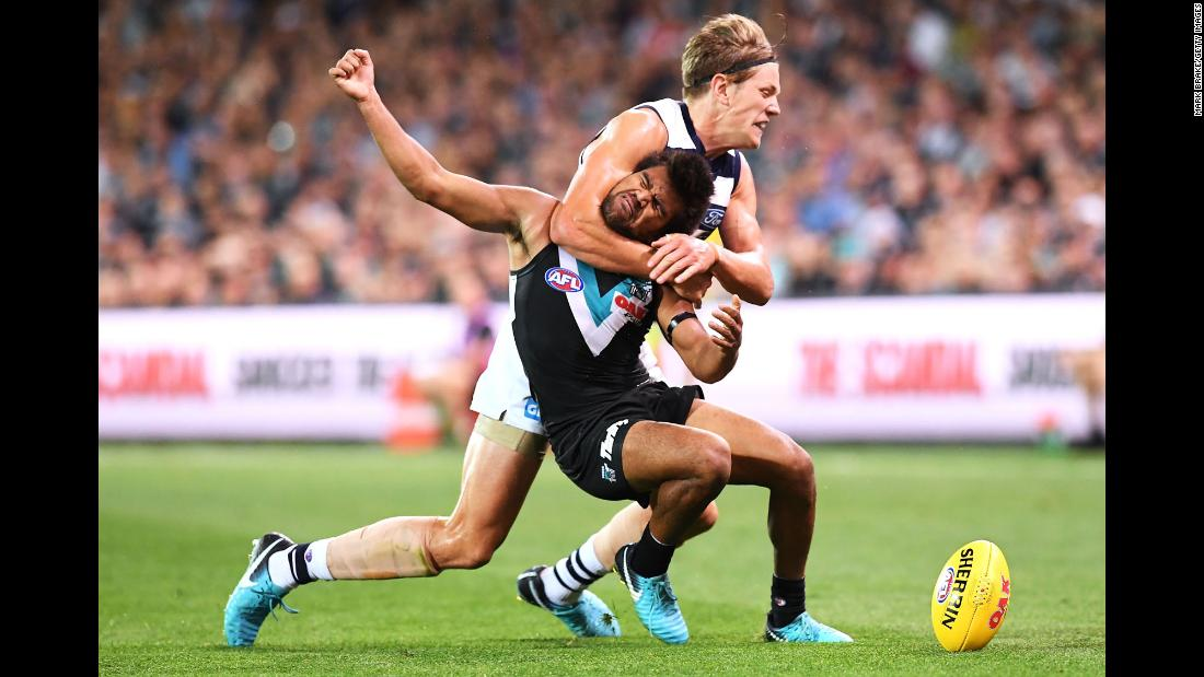 Port Adelaide's Jake Neade is tackled by Geelong's Rhys Stanley during an Australian Football League match on Saturday, April 21.