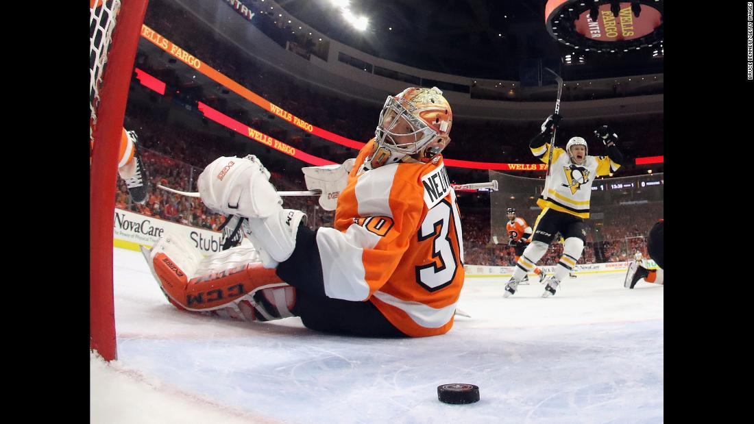 "Philadelphia goalie Michal Neuvirth watches the puck behind him as Pittsburgh's Sidney Crosby, not pictured, scores a goal in Game 6 of their first-round playoff series on Sunday, April 22. Jake Guentzel, right, <a href=""http://bleacherreport.com/articles/2771907"" target=""_blank"">scored four goals in Pittsburgh's 8-5 victory,</a> and the Penguins advanced to the second round."