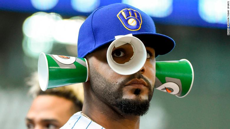 Apr 22, 2018; Milwaukee, WI, USA; Milwaukee Brewers second baseman Jonathan Villar (5) passes time in the dugout in the fourth inning during the game against the Miami Marlins at Miller Park. Mandatory Credit: Benny Sieu-USA TODAY Sports
