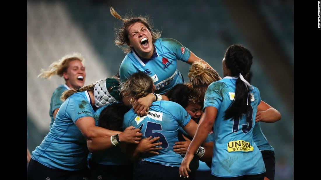 Rugby player Grace Hamilton, top, celebrates with her New South Wales teammates after they won the Super W Grand Final in Sydney on Friday, April 20.