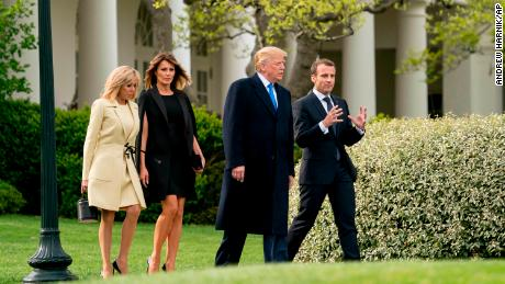 From left, Brigitte Macron, first lady Melania Trump, President Donald Trump and French President Emmanuel Macron, right, walk to a tree planting ceremony on the South Lawn of the White House in Washington, Monday, April 23, 2018.