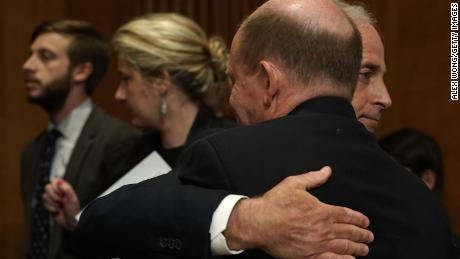 "WASHINGTON, DC - APRIL 23:  U.S. Sen. Bob Corker (R-TN) (R), chairman of the Senate Foreign Relations Committee, hugs Sen. Chris Coons (D-DE) (2nd R) after a committee meeting April 23, 2018 on Capitol Hill in Washington, DC. The committee has approved to the nomination of CIA Director Mike Pompeo to be the next Secretary of State. Sen. Coons broke a deadlock and voted ""present"" to avoid keeping the meeting open until Sen. Johnny Isakson (R-GA) can join the meeting from delivering a eulogy out of town.  (Alex Wong/Getty Images)"