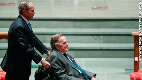 HOUSTON, TX - APRIL 21:  Former president George W. Bush, left, wheels his father, former president George H.W. Bush into the church for the funeral for former first lady Barbara Bush at St. Martin's Episcopal Church on April 21, 2018 in Houston, Texas. Bush, wife of former president George H. W. Bush and mother of former president George W. Bush, died at her home in Houston on April 17 at the age of 92.  (Photo by Brett Coomer - Pool/Getty Images)