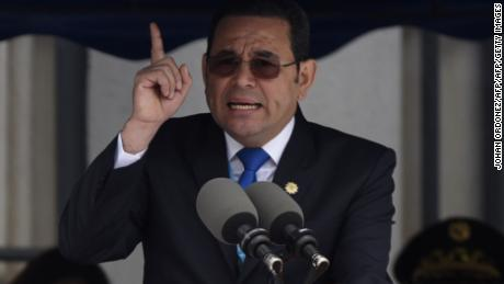 "Guatemalan President Jimmy Morales delivers a speech during a ceremony honouring fallen soldiers, at Campo Marte in Guatemala City, on April 20, 2018. - Morales, supported by his family,  seized the opportunity to speak out against the ""illogical"" denounces against him, on receiving illegal financing for his campaign in 2015, carried out by the country's chief prosecutor, Thelma Aldana and the head of a UN-backed anti-corruption body (CICIG), Colombian Ivan Velasquez. (Photo by JOHAN ORDONEZ / AFP)        (Photo credit should read JOHAN ORDONEZ/AFP/Getty Images)"