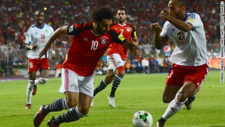 Salah vies for the ball against Congo's Tobias Badila during their World Cup qualifying game.