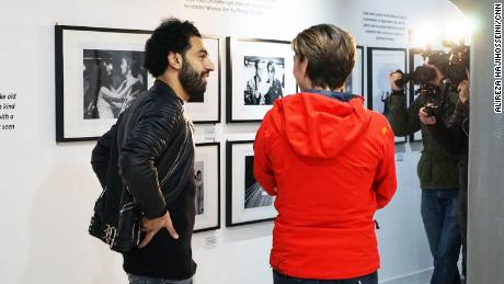 Salah takes a look around the exhibits at the Beatles Museum.