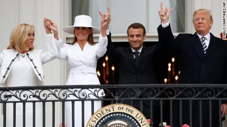 President Donald Trump, French President Emmanuel Macron, first lady Melania Trump and Brigitte Macron hold hands on the White House balcony during a State Arrival Ceremony at the White House in Washington, Tuesday, April 24, 2018. (AP Photo/Pablo Martinez Monsivais)