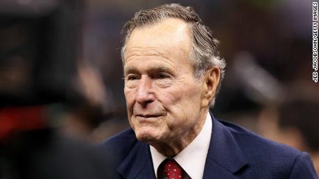 NEW ORLEANS - JANUARY 24:  Former US President George H. W. Bush (R) stands on the field prior to the New Orleans Saints playing against the Minnesota Vikings during the NFC Championship Game at the Louisana Superdome on January 24, 2010 in New Orleans, Louisiana.  (Photo by Jed Jacobsohn/Getty Images)