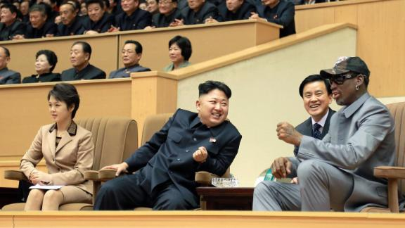 Ri and Kim sit alongside former US NBA star Dennis Rodman as they watch an exhibition match between US and North Korean basketball players in Pyongyang on January 8, 2014. Rodman later revealed the name of the couple