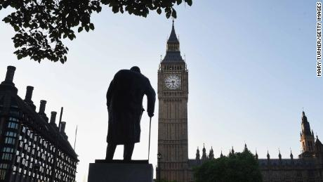 A statue of former British Prime Minister Winston Churchill stands opposite Parliament.