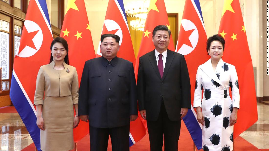Ri and Kim pose alongside Chinese President Xi Jinping and his wife, Peng Liyuan, during a state visit to Beijing in March 2018.