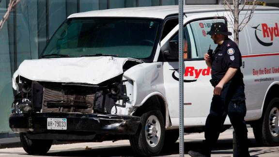 Police inspect a van used to strike pedestrians in the North York area of Toronto on Monday, April 23. Multiple people were killed or injured as the van swerved onto the sidewalk, plowing over people in its path.