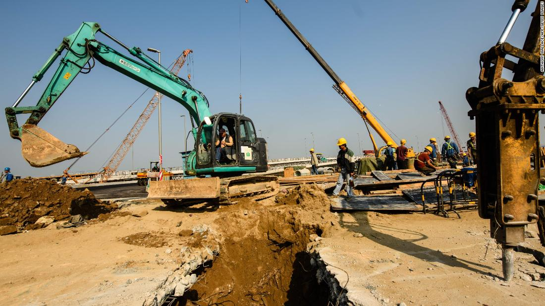 Construction workers building a road in Macau that will connect the territory to the Hong Kong-Zhuhai-Macau Bridge.