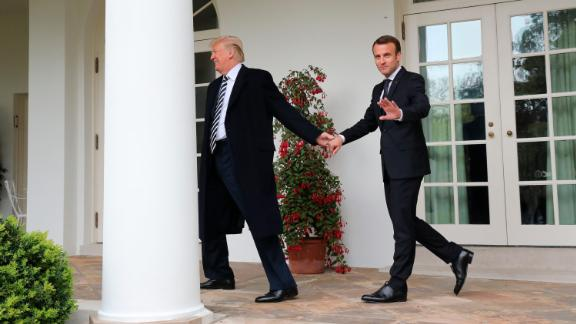 President Donald Trump and French President Emmanuel Macron walk to the Oval Office on April 24.