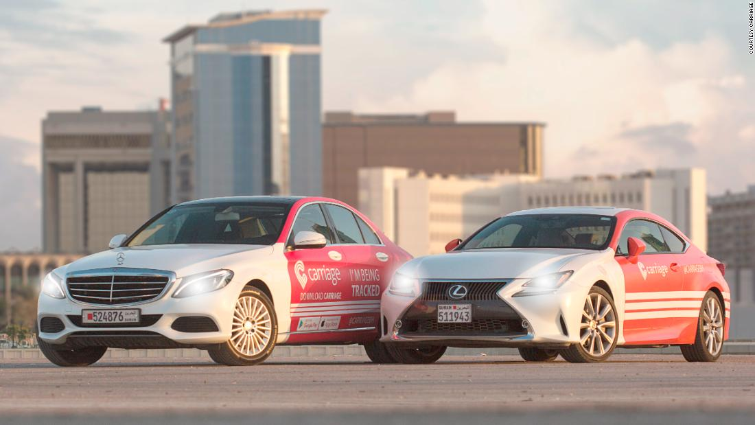 Two cars embossed with the corporate logo of Carriage.