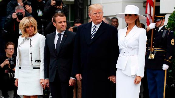 President Donald Trump, first lady Melania Trump, French President Emmanuel Macron and his wife Brigitte Macron stand together at the beginning of the State Arrival Ceremony at the White House in Washington, Tuesday, April 24, 2018. (AP Photo/Carolyn Kaster)