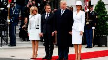 President Donald Trump, first lady Melania Trump, French President Emmanuel Macron and his wife Brigitte Macron stand together at the beginning of the State Arrival Ceremony at the White House in Washington, Tuesday, April 24, 2018. [AP Photo/Carolyn Kaster)
