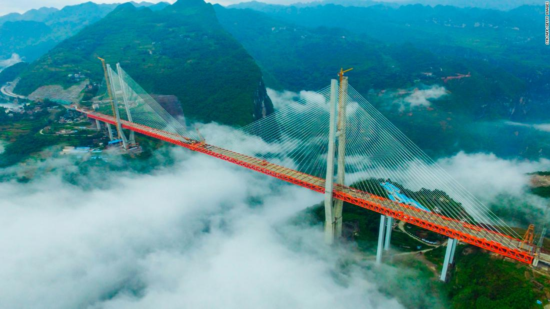 The Beipanjiang Suspension Bridge soars a terrifying 1,854 feet above a river in southwest China's Guizhou province.