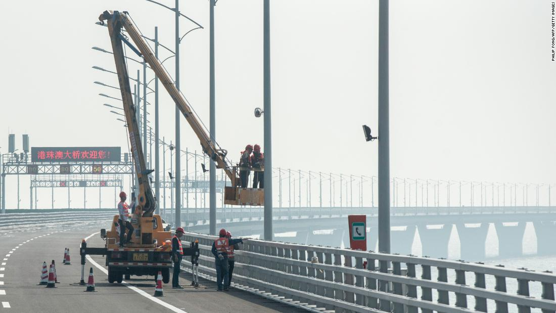 Construction workers put the finishing touches to a section of the Hong Kong-Zhuhai-Macau Bridge in Zhuhai.