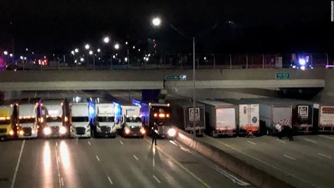 A man was threatening to jump off an overpass. Big rigs parked underneath to break his fall