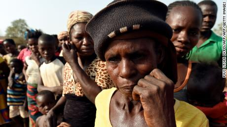 "Women look on at the internally displaced people camp occupied largely by women and children affected by herders and farmer's violent clashes from Logo and Guma communities at Gbajimba IDPs camp on the outskirts of Makurdi, capital of  Benue State in northcentral Nigeria on January 3, 2018. Nomadic cattle herders have all but left Benue state, driven away by fighting over access to resources and a new law banning migratory herding, an age-old practice necessary for the survival of the livestock. More than 100 people have been killed since early January, with 100,000 fleeing their homes to safety, according to the local emergency management agency (SEMA). After months of inaction, the Nigerian army announced the imminent deployment of troops for ""Operation Cat Race"" in several city states, including Benue to end the violence.  / AFP PHOTO / PIUS UTOMI EKPEI        (Photo credit should read PIUS UTOMI EKPEI/AFP/Getty Images)"