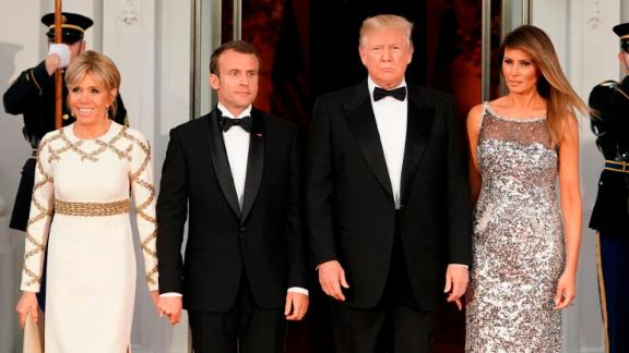 The Trumps pose with French President Emmanuel Macron and his wife Brigitte before Tuesday's dinner.