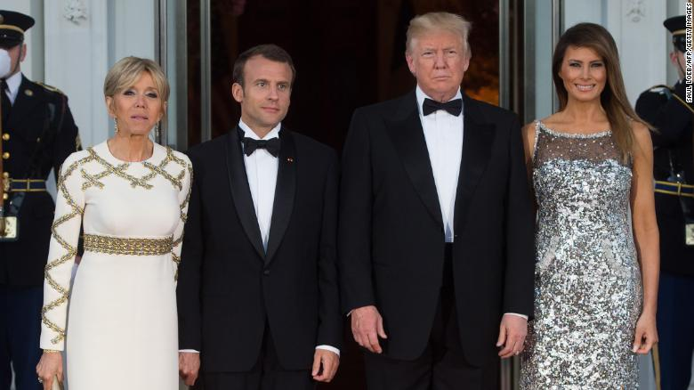 US President Donald Trump and First Lady Melania Trump pose with French President Emmanuel Macron and his wife Brigitte before a State Dinner at the White House.