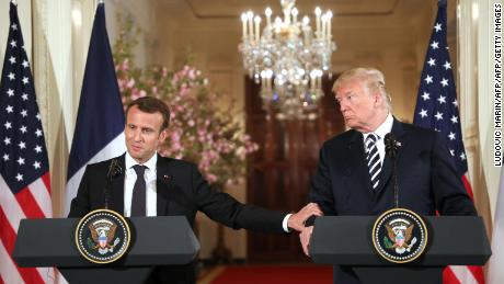 US President Donald Trump and French President Emmanuel Macron shake hands during a joint press conference at the White House in Washington, DC, on April 24, 2018. (Photo by Ludovic MARIN / AFP)        (Photo credit should read LUDOVIC MARIN/AFP/Getty Images)