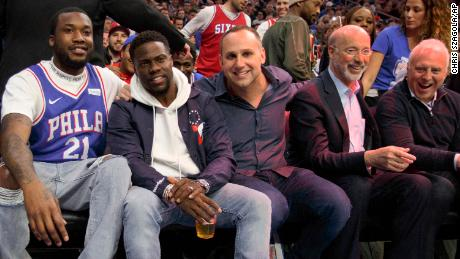 Rapper Meek Mill, left, watches the game with actor Kevin Hart, center left, Philadelphia 76ers' co-owner Michael Rubin, center, Pennsylvania Gov. Tom Wolf, center right, and Philadelphia Eagles' owner Jeffery Lurie, right, during the first half in Game 5 of a first-round NBA basketball playoff series against the Miami Heat, Tuesday, April 24, 2018, in Philadelphia. (AP Photo/Chris Szagola)