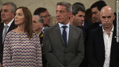 Buenos Aires governor Maria Eugenia Vidal (L) Chubut governor Mariano Arcioni (C) and Buenos Aires Mayor Horacio Rodriguez Larreta gesture before the speech of Argentine President Mauricio Macri (not in frame) during the inauguration of the 136th period of ordinary sessions at the Congress in Buenos Aires, Argentina on March 1, 2018. / AFP PHOTO / JUAN MABROMATA        (Photo credit should read JUAN MABROMATA/AFP/Getty Images)