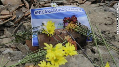 View of flowers placed over the rubble of the University Center of Nicaragua's National University (CUUN) on April 24, 2018 in the Nicaraguan city of Leon, after it was set on fire during protests against President Daniel Ortega's government on April 21. - The Nicaraguan city of Leon, one of the bastions of the Sandinista left in Nicaragua is fed up of repression and authoritarianism and stands against Daniel Ortega's government. (Photo by INTI OCON / AFP) / TO GO WITH AFP STORY by Blanca MOREL        (Photo credit should read INTI OCON/AFP/Getty Images)