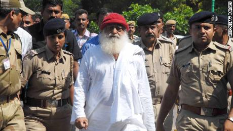 (FILES) In this file photo taken on October 14, 2013 Indian spiritual guru Asaram Bapu (C), accused of sexually assaulting a minor, is escorted by Gujarat state police in Jodhpur.