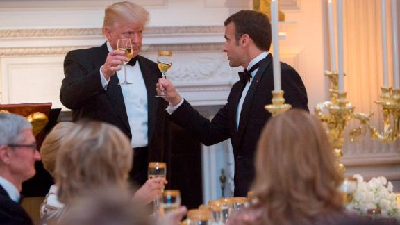 US President Donald Trump shares a toast with French President Emmanuel Macron, April 24, 2018.