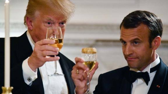 US President Donald Trump (L) and French President Emmanuel Macron (R) toast during a State Dinner in honor of Macron at the White House in Washington, DC, April 24, 2018. (Photo by Nicholas Kamm / AFP)        (Photo credit should read NICHOLAS KAMM/AFP/Getty Images)