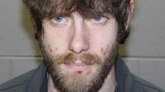 John Williams, 29, is suspected of killing a police officer in central Maine, police say.